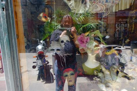 Reflecting in the window of a Masque Store in Venice